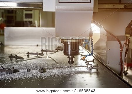 Cnc machine drilling metal. Drill and stainless steel.