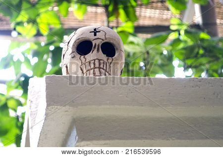 OAXACA, OAXACA, MEXICO- NOVEMBER 1, 2017: White skull made of clay as decoration at mexican Day of the Dead celebration in Oaxaca, Mexico