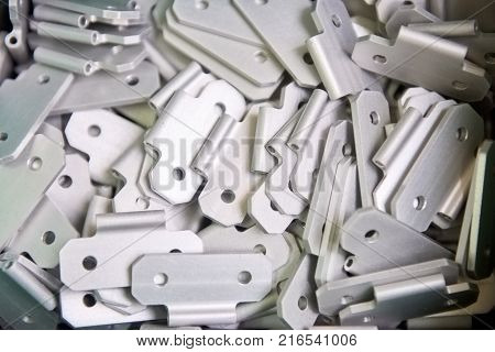 Metal door hinges close-up. Pile of a metal details.