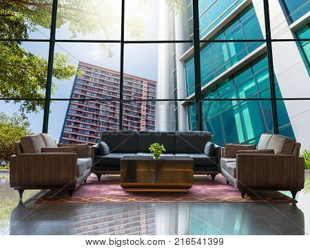 Lobby area of a hotel which can see Modern business building glass of skyscrapers with sun