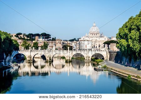 View to the St. Peter's basilica from the Tiber river in Rome Italy.