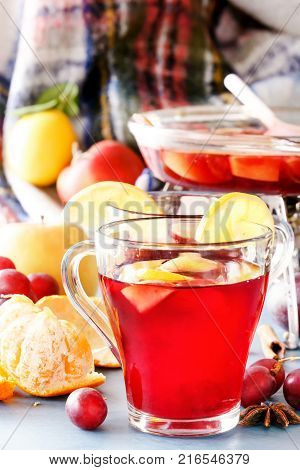 Glass jars with mulled wine. Hot wine for winter. Mulled wine, punch, grog. Hot fruit tea. Spices, fruit
