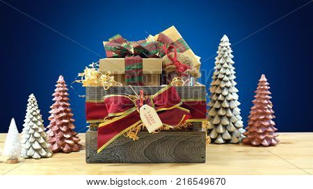 Large English style traditional Christmas hamper with paper wrapped gifts and food.