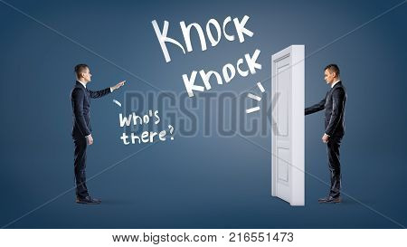 A businessman knocks at a white door on a blue background with another man asking him to name himself. Unexpected business situations. Business partnership. Know your colleagues.