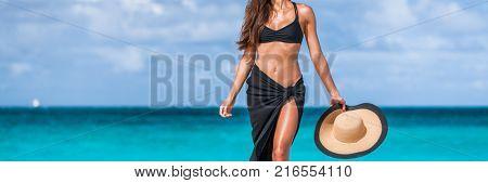 Beach vacation bikini body fashion woman banner. Stomach and slim waistline weight loss suntan girl. Luxury travel skin care panorama copy space crop.