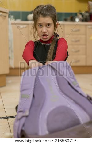Sweet Beautiful Little Schoolgirl Tired And Exhausted Carrying On Her Back Heavy School Backpack Loo