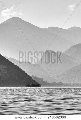 Silhouettes of mountains over the lake Skadar in Montenegro