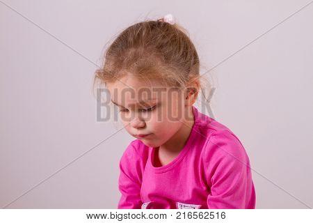 Portrait of a Sad girl on white background