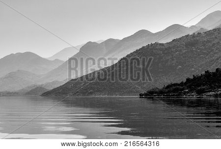 Misty mountains over the lake Skadar in Montenegro