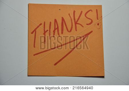 word thanks on an  abstract colored background