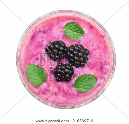 blackberry yogurt or smoothie with mint leaves isolated on white background. Top view. Healthy Eating.