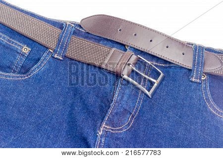Casual brown elastic stretch belt for men with leather ends and classical buckle passed through the belt loops of the blue jeans