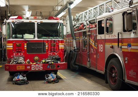 New York City, USA - Nov 15, 2011 : New York Fire Department trucks in a fire station.