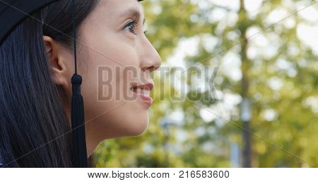 Side profile of woman with graduation mortarboard