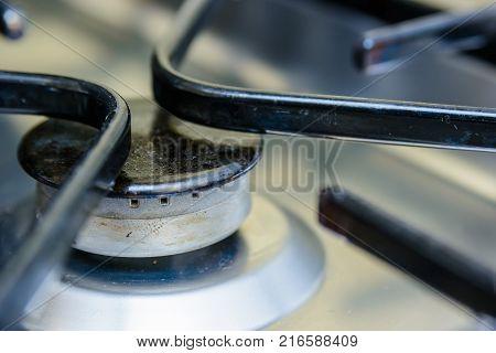 Close up black burner on modern kitchen stove poster
