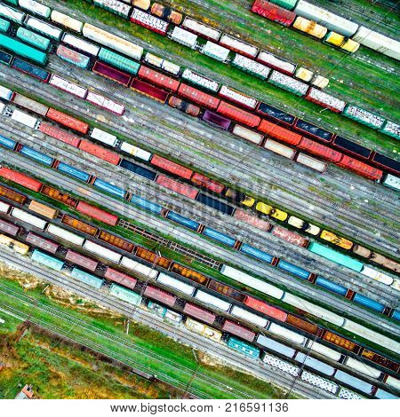 aerial shoot of railway tracks with lots of colorful train wagons