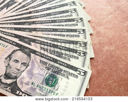 US currency money with five dollar banknote. Business and finance concept.