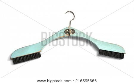Vintage folding hanger with built in two brushes,  special clotheshanger from 1930s in light blue color, with stained flaking lacquer