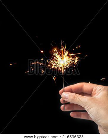 Women Hand holding Sparkling beautiful sparkles or bengal lights. Christmas concept idea