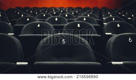 Inside Of Auditorium Movie Theatre With Seats And Numbers.