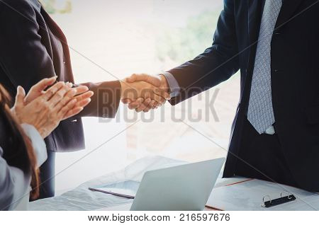group of business people handshake and clapping hand after finishing up a business meeting in office success meeting partner teamwork community connection concept vintage tone selective focus