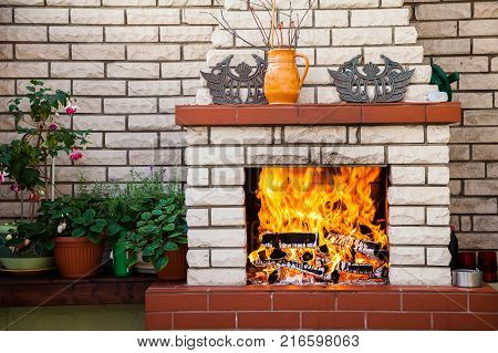 the cozy outdoor fireplace on a patio