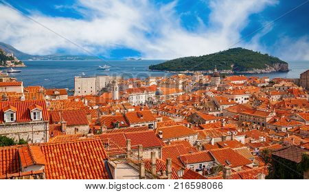Dubrovnik red roofs houses and green island Lokrum in a background Croatia