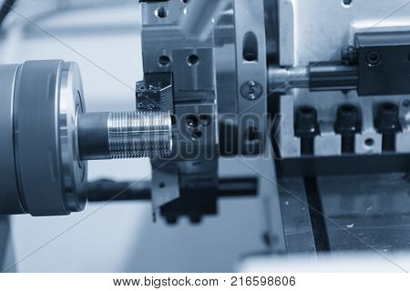 CNC lathe machine (Turning machine) cutting the metal screw thread tube part.Thread machining process.