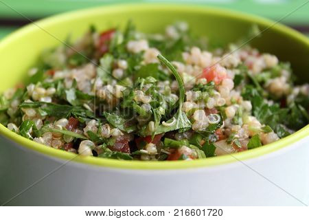 A healthy bowl of Lebanese quinoa tabbouleh.