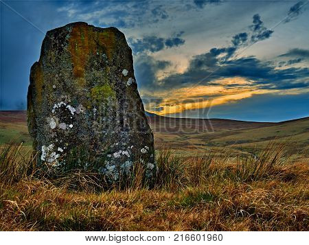The Waun Leuci standing stone situated in the Tawe Valley is a massive slab 2.2m high, 1.5 meters wide and .25m at it's thickest. Part of a Bronze Age complex of monuments it is oriented north-north-east to south-south-west to align  poster