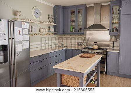 Country style kitchen in a contemporary residential home with an island and modern appliances
