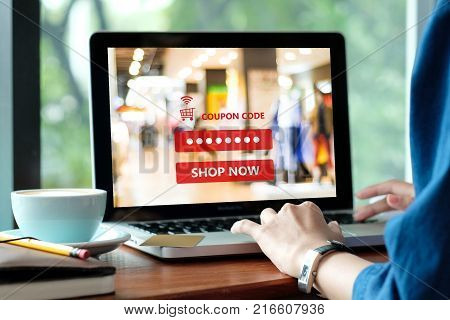 Woman typing discount coupon code on laptop screen to get the shopping on line promotion on line shopping digital marketing business and technology lifestyle concept
