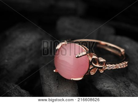 Jewelery ring on dark coal background copy cpace