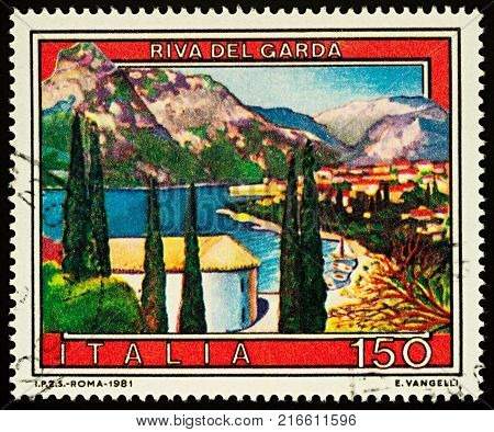 Moscow Russia - December 03 2017: A stamp printed in Italy shows town of Riva del Garda in northern Italy series