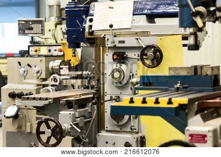 Metalworking machines, lathes and vertical milling machines.