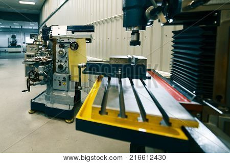 Machining shop, two vertical milling machine. Metalworking equipment