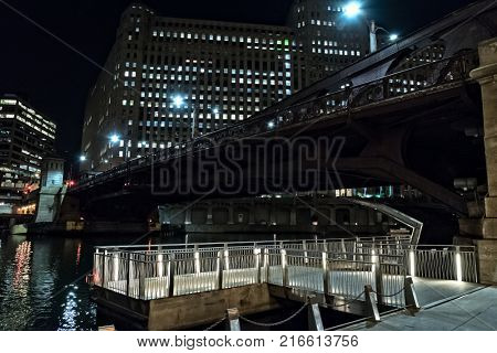 Chicago city riverwalk promenade at night with vintage drawbridg