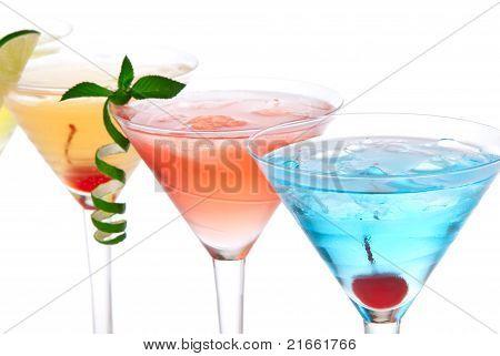 Martini Alcohol Cocktails In Row Blue Hawaiian, Tequila Sunrise