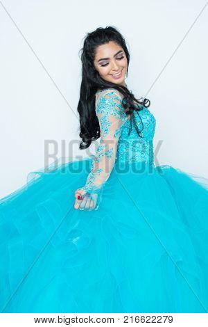 Hispanic teenage girl wearing a dress for a dance