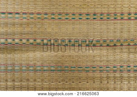 Close up texture of native thai style weave sedge mat background made from papyrus.