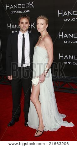 LOS ANGELES - JUN 30: Charlize Theron and Stuart Townsend at the premiere of 'Hancock' in Los Angeles, California on June 30, 2008