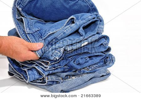 Man inspecting a pair of jeans