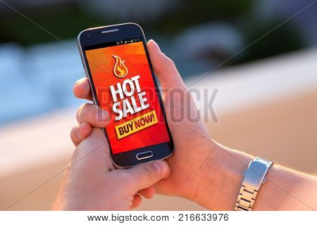 Girl with smartphone. Hot sale shopping offer on the screen of this. Young woman. Millennial. Internet business. Sales.