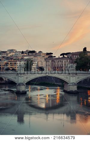 River Tiber and Rome ancient architecture with colorful sky at sunset, Italy.