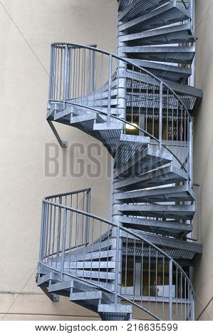 Metal spiral staircase / Fragment of the house with a metal staircase
