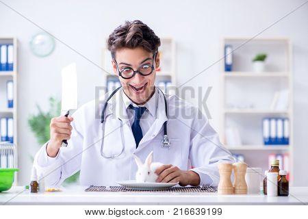 Mad crazy doctor preparing to eat rabbit