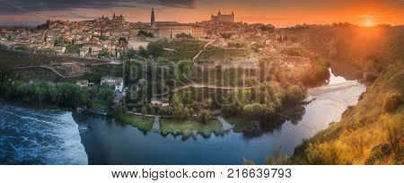 Panorama view of ancient city and Alcazar on a hill over the Tagus River, Castilla la Mancha, Toledo, Spain
