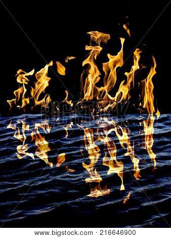 flame fire with reflection in water . Photo of an abstract texture