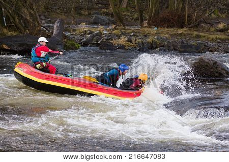 Llangollen Wales UK - January 28 2017: White water rafters negotiating the rapids on the River Dee in North Wales