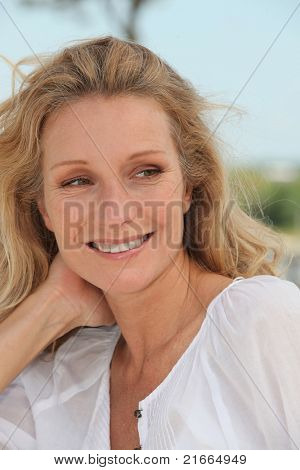 Carefree woman relaxing on a sunny breezy day